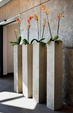 Tall planters can decorate a large space or serve as a focal point for several smaller plants. There are alternate ways to fill your planters. Concrete Furniture, Concrete Pots, Concrete Crafts, Recycled Furniture, Tall Planters, Indoor Planters, Ceramic Planters, Orchid Planters, Cement Planters