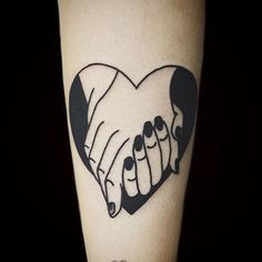 Black hands holding tattoo