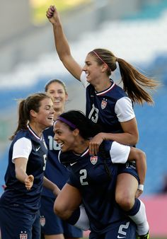 Alex Morgan celebrates with teammates after scoring the opening goal against Germany in the 2013 Algarve Cup final. The United States went on to win 2-0. (Armando Franca/AP)