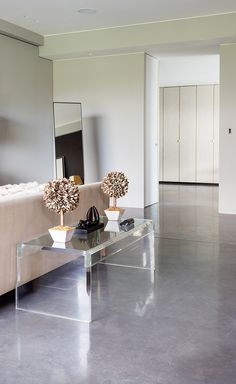 Stunning West London apartment featuring a Mayfair Grey Lazenby Polished Concrete Floor with a Satin Architect: Gumuchdjian Architects Photographer: Jeremy Philips Flooring, Polished Concrete, London Apartment, Apartment, Remodel, Furniture, Home, Concrete Floors, Home Decor