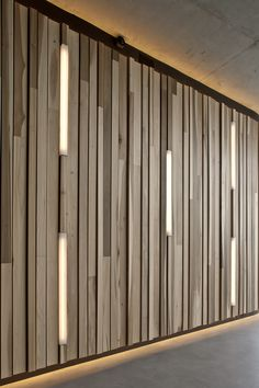 Frits van Dongen and Patrick Koschuch specified American tulipwood cladding for the curved walls in the foyer because they were attracted to tulipwood's varied natural tones with cream white and pale olive green in the sapwood contrasting with dark purple, brown and olive streaks in the heartwood.