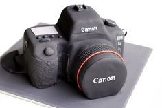 Canon camera cake    Another slr camera cake! Chocolate mud with chocolate ganache. front