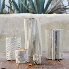 would also grab a couple of these for little vignettes, Stripes + Dots Mercury Hurricanes  #westelm