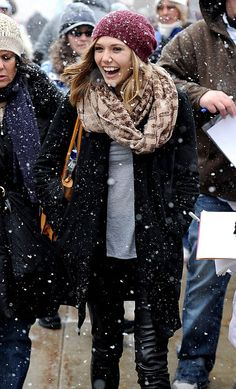 Elizabeth Olsen pulls off a hat and pleather pants.