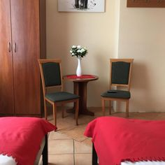 Willa Wiktoria is situated In Zakopane, at the foot of the Antałówka Mountain. It features spacious rooms with free Wi-Fi, a TV and an electric kettle. Floor Chair, Flooring, Room, Furniture, Home Decor, Bedroom, Decoration Home, Room Decor, Wood Flooring