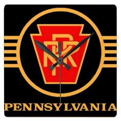 Pennsylvania Railroad Logo, Black & Gold Wall Clock from zazzle/stanrail -$30.95- It's time to show off your favorite art, photos, and text with a custom square wall clock from Zazzle. Made for any wall, this clock is vibrantly printed with AcryliPrint®HD process to ensure the highest quality display of any content. Order this custom square wall clock for your home or give to friends and family as a gift for a timeless treasure.