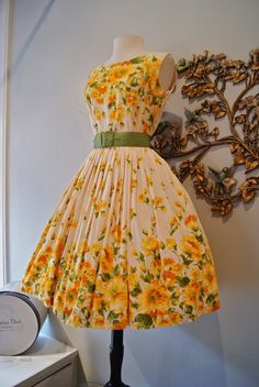 Early 60's polished cotton border print dress with sun soaked blossoms.