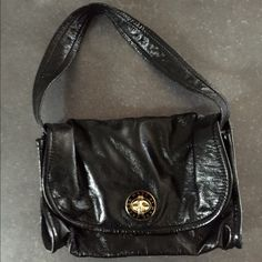 Marc by Marc Jacobs leather bag in black Marc by Marc Jacobs leather bag in black. Medium sized. Compartments inside with cell phone holder. Great condition. Marc by Marc Jacobs Bags Shoulder Bags