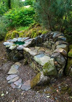 Infinity Seat, by Max Nowell http://www.maxnowellsculpture.co.uk. Dry stone seat and wee barrel-pond in a woodland garden near Moniaive, Thornhill, Dumfries and Galloway, UK.