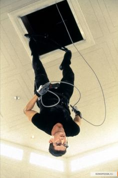 "Tom Cruise as Ethan Hunt in ""Mission: Impossible"" (1996)  Sounds like a good movie to see better watch the trailer first"