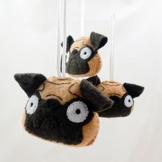 handmade plush pug ornament. http://treefortfive.storenvy.com/products/3840457-plush-felt-pug-dog-ornament