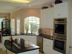 Uba-Tuba-granite-countertops-with-white-cabinets-kitchen-ideas-kitchen-remodel