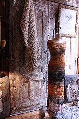 Loopy Mango interior: alpaca throw made with Loopy Mango Big Loop yarn, cotton knitted dress made with Lang Sol Degrade yarn, rug crocheted with Big Loop alpaca yarn, framed vintage drawing.