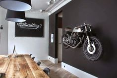 man cave garage Discover the art of decorating your manly space with the top 100 best man cave decor ideas for men. Explore cool interior designs, wall art and more. Motorcycle Shop, Motorcycle Garage, Motorcycle Workshop, Motorcycle Man Cave Ideas, Motorcycle Helmets, Black Painted Walls, Deco Cool, Man Cave Garage, Car Man Cave
