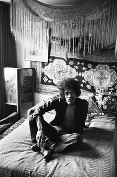 Jimi Hendrix in his bedroom