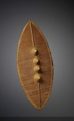 Africa | Warriors Shield. Soga culture, Sudan | ca. 19th century | Wood and Rattan