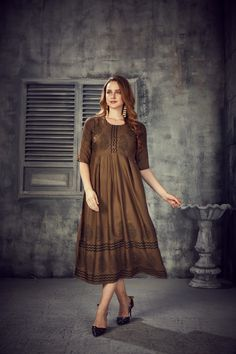 Women's Brown Colored Rayon 2 Tone Pleated Kurti With Foil - gnp007245| Visit : www.grabandpack.com | TO BUY THIS BEAUTIFUL OUTFIT CONTACT US / WHATS APP US ON : +91 9898133588 || EMAIL US AT grabandpack@gmail.com || you can visit on www.grabandpack.com | #style #chennai #cotton  #sareeinspiration #sareesonline #bridalsarees #pet #sareeseduction  #saree2020 #2020trending #kurti #chex #sleeveless #walkway #pleated #indowestern #kurti #straight #charming #bluehills #pearl #handwork #foilprint Stylish Kurtis, Bridesmaid Dresses, Wedding Dresses, Sarees Online, Half Sleeves, Beautiful Outfits, Walkway, Chennai, Brown