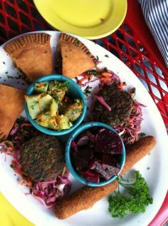 Great Cuban food in a colorful building with a cheap happy hour!