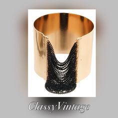 Gold cuff bracelet with black chain accent Stunning and unusual gold cuff bracelet with hanging black chain accent. Boutique Jewelry Bracelets