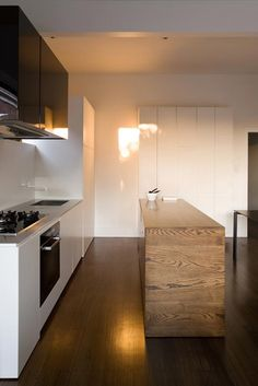prahran residence | kitchen ~ meme design Love the stark white, minimalist cabinets next to the old wood table