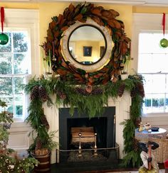 The mantle all decked out with #cedargarland and mirror with #magnoliagarland accented with extra large pine cones. Cedar has a wonderful…