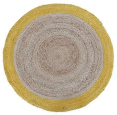 'Starburst' Natural Jute Rug   We love the vibrancy this natural jute rug exudes. Designed by us, RAW Sunshine Coast, we've had the 'Starburst' rug hand woven from sustainable natural fibres in Agra, India by a talented team of artisans. It features plaited fibres in a beautiful circular pattern with a pop of colour on the edge and would add texture and warmth to any room.  Colour: Natural and Yellow Edge   Size: 900mm round (also available in 1200mm)      Each rug is hand woven, mak...
