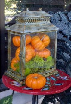 2-minute fall decoration: Mini pumpkins in a lantern-like terranium on the front porch