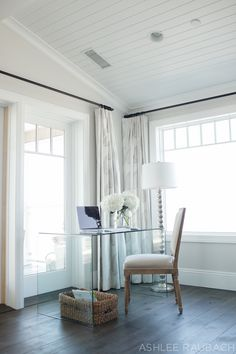 If we put a bench at the end of guest bed something like this in guest room between front windows could be beautiful and practical.