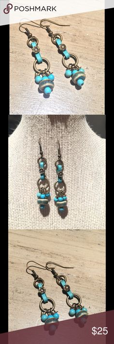 Turquoise and leather earrings Turquoise and leather earrings. Brass metal French wires. Hangs 2 inches from top to bottom. handmade Jewelry Earrings