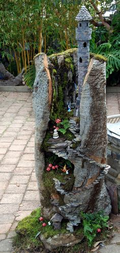 Beautiful fairy garden plants ideas for around your side home 47