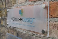 Clear Acrylic Plaque complete with frosting, company logo and brushed steel corner fixings.