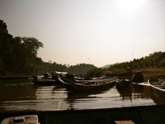 Boats waiting to take tourists to Tad Sae Falls - Luang Prabang Luang Prabang, Boats, Waiting, River, Outdoor, Outdoors, Ships, Outdoor Games, The Great Outdoors