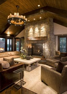 Chandelier, stone, wood, warm cozy feel, colors, lots of seating