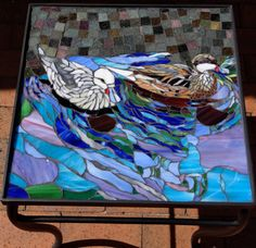Glass mosaic pintail ducks on wrought iron table