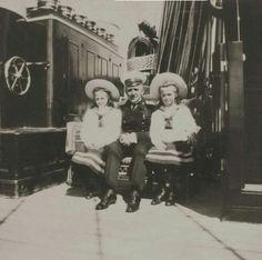 "Grand Duchesses Tatiana and Olga Nikolaevna Romanova of Russia with Nikolai Pavlovich Sablin on board the Imperial Royal yacht,the Standart in 1908. ""AL"""