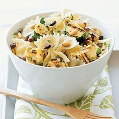 Here's a great way to use summer's abundant squashes. Toasted pine nuts and briny kalamata olives make this pasta salad a standout.