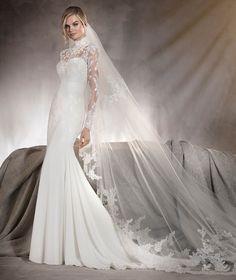 El vestido de novia ARIELLA es un modelo alucinante de escote corazón en gasa, tul con encaje en mangas y cuello alto semitransparente que será la sensación.