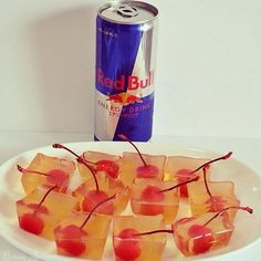 Red Bull Vodka Jello Shots -1 Cup Vodka -1 Cup Red Bull -1 Packet of Gelatin - Cherries with Stems I used an Ice cube tray.