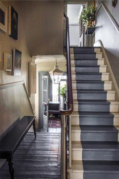 Dark grey painted stairs & floor. Lovely wooden handrail.