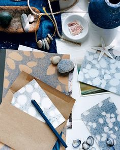 Decorate stationery, postcards, or a travel journal using shells, stones, and other tokens collected on a recent trip.