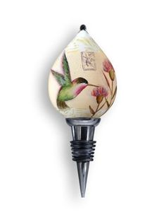 Wine Stopper, Hummingbird Design, 6-Inches Tall by Ne'Qwa. $35.99. Mouth Blown Glass wine stopper, reverse hand-painted. Each piece is individually hand painted from the inside by our skilled artisans. Floral Hummingbird Design by noted artist, Susan Winget. Each item is luxuriously housed in a velour and satin presentation case with protection in mind.  Makes a great item for your home or as a gift.. Features licensed art from leading gift industry artists. This...