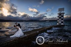 Bride and groom's wedding photos at Halswell point lighthouse. Wellington weddings by PaulMichaels photography http://www.paulmichaels.co.nz/bede-dawn-wedding/