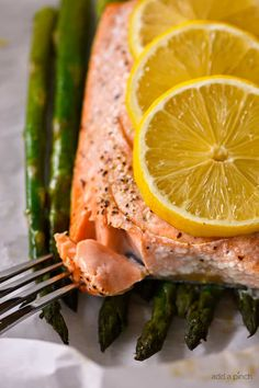 Lemon Garlic Salmon and Asparagus Parchment Packet Recipe – This quick and easy recipe comes together in a snap and is ready and on the table in 15 minutes! Easy meals are a weeknight staple at my house and I'm always striving to make them as healthy and delicious for my family as I possibly...
