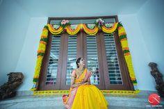 South Indian bride. Yellow silk sari.
