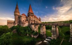 Download wallpapers Corvin Castle, ancient castle, sunset, Transylvania, Romania, bridge, stone castle
