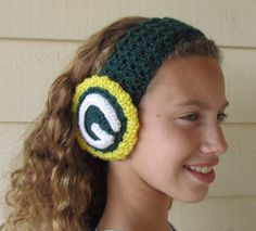 Check out this shop...she makes the cutest and MOST unique hats....the football helmet hats are amazing.  I have two for the twins and she'll do any colors/team you want!  I also happen to know & love her for 20+ years so you can trust her ;)    Green Bay Packer Crochet Headband Earwarmer by inspired3crochet, $18.50