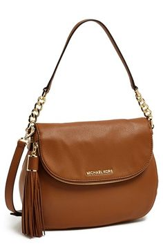 Free shipping and returns on MICHAEL Michael Kors 'Bedford Tassel - Medium' Convertible Leather Shoulder Bag at Nordstrom.com. A lavish tassel with gleaming goldtone logo hardware swings from the zip-around flap of a lightly textured leather shoulder bag. An optional crossbody strap adds a convenient carrying option, and raised goldtone logo letters provide graceful branding.