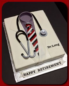 Doctor lab coat cake, complete with stethoscope:)