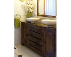 There are some challenges in converting an antique dresser into a vanity for your bathroom. Since the item was not really created to be a vanity it will more than likely not be waterproof. You will need to seal it so that it will not be damaged by water, steam, and high humidity of a bathroom     http://www.vastinterior.com.au/vast-decorator/trends-and-designs/australia/vanity-flair-%281%29.aspx
