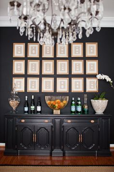 The walls and console were painted in Benjamin Moore, Black Satin and spruced up the hardware with Krylon Gold Spray Paint